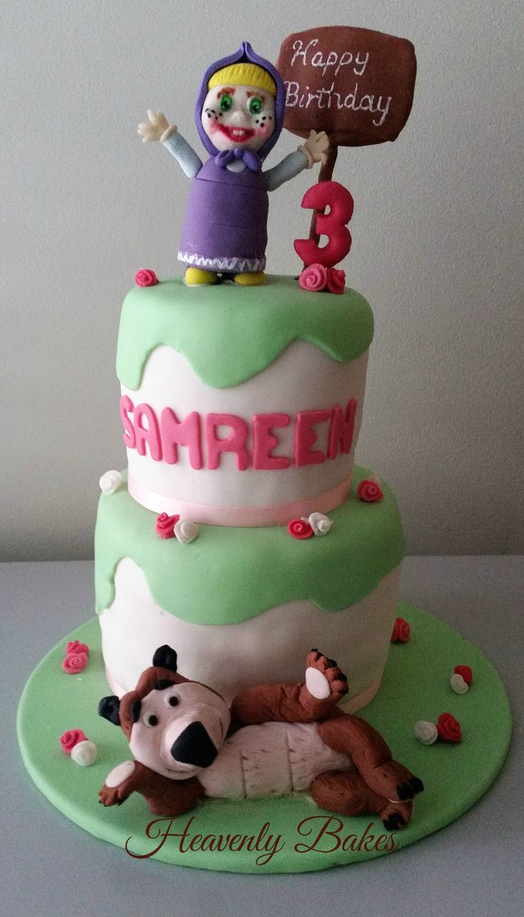 Masha and the Bear toppers on a 2 tier rainbow birthday cake. facebook://heavenlybakesaltona