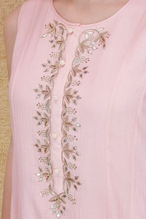 A blush cotton georgette sleeveless suit with front gathers and floral gota patti embroidery around the placket, inspired by a magical forest.