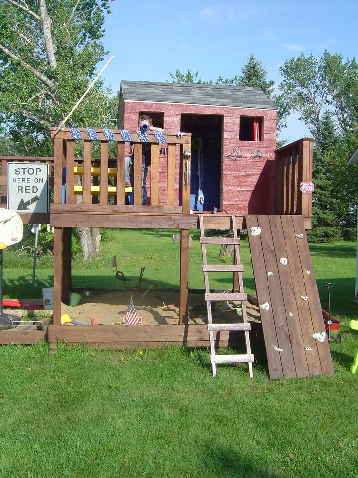 Kids fort swing set climbing rocks ladder slide fort for Homemade forts outdoors