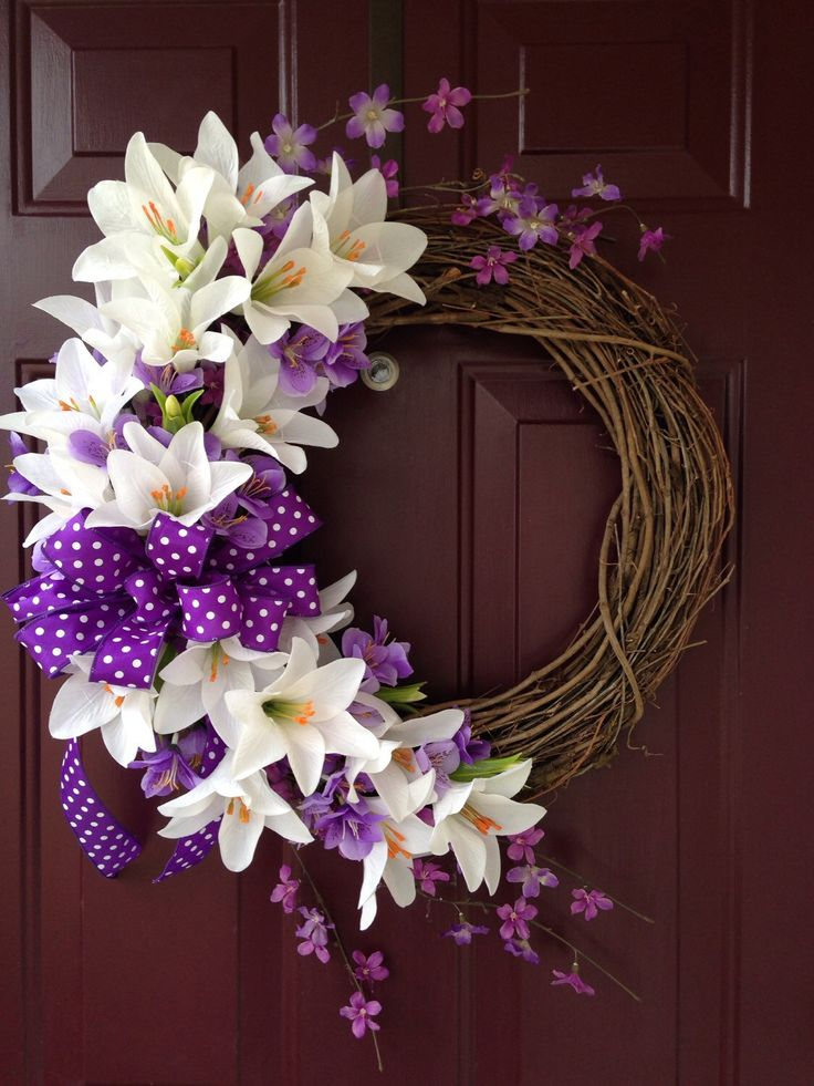 Easter Lilly Floral Grapevine Wreath With Purple Accents by BeccasFrontDoorDecor on Etsy https://www.etsy.com/listing/227730683/easter-lilly-floral-grapevine-wreath