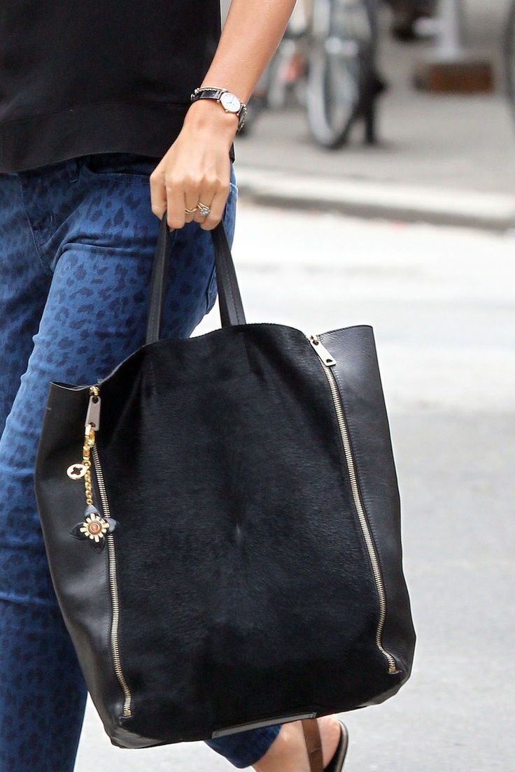 What are the need-to-have bag styles for spring according to @EmilyandMeritt? Must-Have #1: A Tote. Must-Have #2: A Backpack. Must-Have #3: A Clutch.