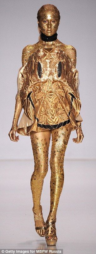 Going for gold: Fyodor Golans bling bodice was one of Moscow Fashion Weekss oddest looks so far