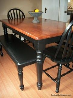 black painting dining table with stained top gives it a more country/casual feel