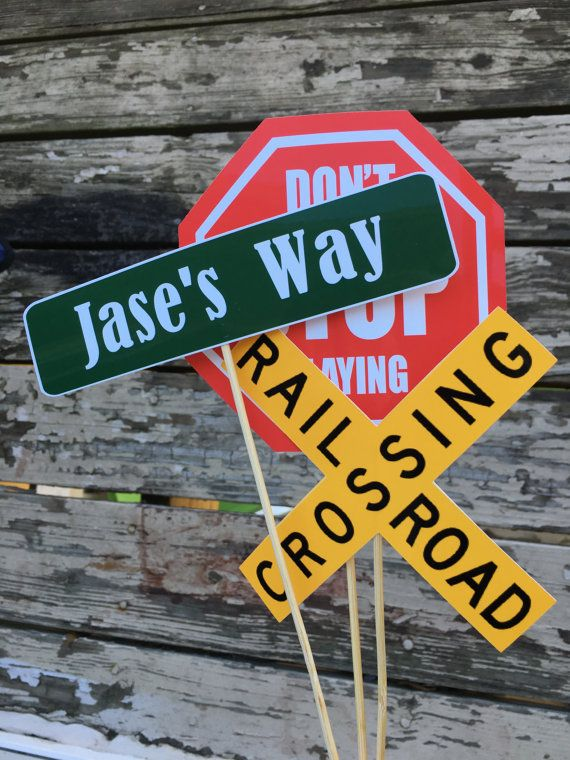These signs are the perfect compliment to your next transportation themed party.  This listing is for 6 transportation signs. The sizing does not include the sticks: Route: 4 x 4 inches Stop sign: 5 1/4 x 5 1/4 inches Railroad Crossing: 5 x 5 inches Traffic Light: 2 x 5 inches Custom Street: 7 1/4 x 1 3/4 inches Speed Limit: 4 1/4 x 5 1/4 inches Active Party: 4 x 6 inches Yield sign: 5 x 5 1/4 inches Party Zone: 5 x 5 inches Interstate: 5 x 4 1/2 inches Please Enter: 5 1/2 x 5 1/2 inches…