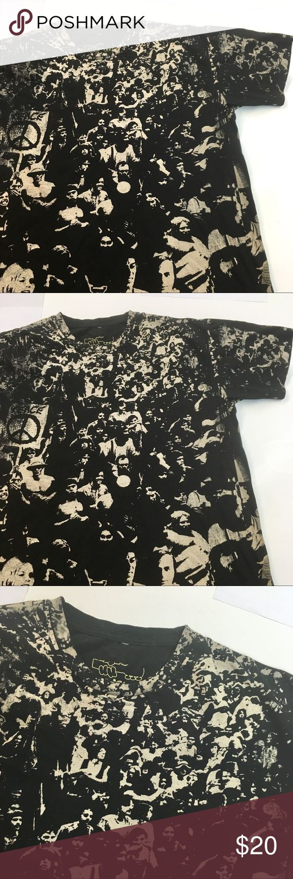 """Woodstock Concert Graphic T Shirt This is a graphic T Shirt by Woodstock brand. Size Large. 100% cotton- width is 22"""" across and length is 25.5"""".  Awesome full body photo of the actual 1969 concert - this shirt was printed 2009. In the red circle photo you can see a manufacturer error. Shirt is in amazing condition. woodstock Shirts Tees - Short Sleeve"""