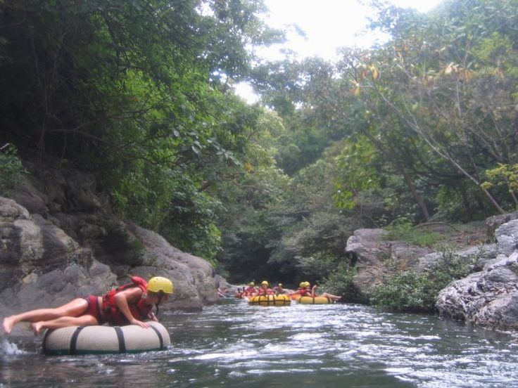 Relaxing while white water tubing