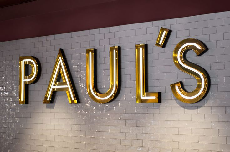 Neon signage for Stockholm-based restaurant Paul's at Haymarket by 25AH, Sweden