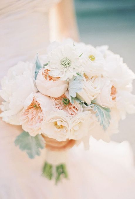 Brides.com: 12 Romantic Peony Wedding Bouquets . A Peach Peony Wedding Bouquet. Peach peonies are every bit as lovely as their pink counterparts, especially when paired with other lightly-colored buds.  See more spring wedding bouquets.