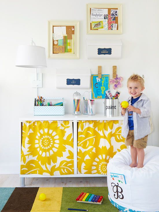 Hide your kids' clutter with curtains on your storage units: http://www.bhg.com/decorating/do-it-yourself/accents/easy-weekend-decorating-projects/?socsrc=bhgpin011914concealedstorage&page=23