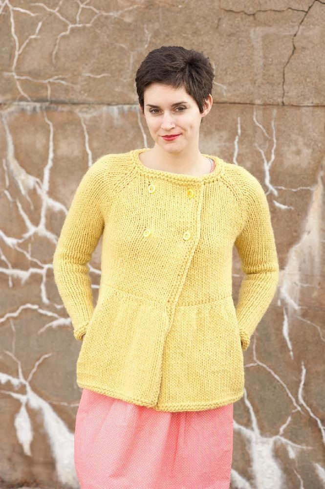 """Canby is a jacket with overlapping, double breasted fronts and a skirted bottom.The top is worked from the top down, the bottom from the bottom up, then the two pieces are joined using a three needle bind off.The bulky gauge of the yarn and the added pockets will keep you warm and cosy.The sample shown was knit inQuince & Co. Puffin, shade Carrie'sYellow and Osprey, shadeBird's Egg.Gauge: 10 sts and 15 rows = 4"""" in Stockinette Stitch with larger needles."""