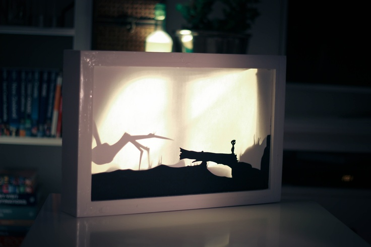 Shadow canvas from a scene in the game Limbo. The shadows from paper silhouettes are cast on to the canvas from behind.
