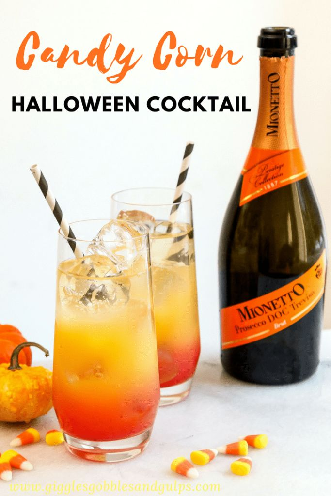 Candy Corn Halloween Cocktail perfect for Halloween and easy to make featuring grenadine, orange juice and prosecco. http://gigglesgobblesandgulps.com/candy-corn-cocktail-halloween/