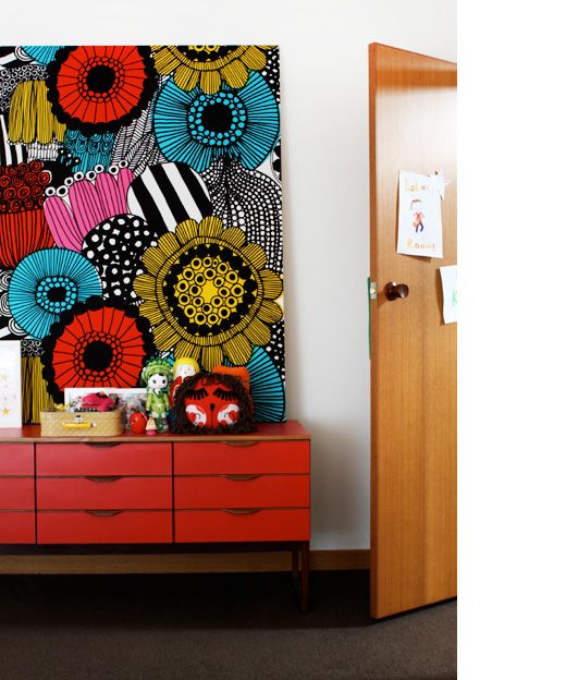 Marimekko fabric on wall makes a fantastic piece of art and highlights the Mid-century sideboard so well. (http://cimmermann.co.uk/blog/scandinavian-style-uncovered/)