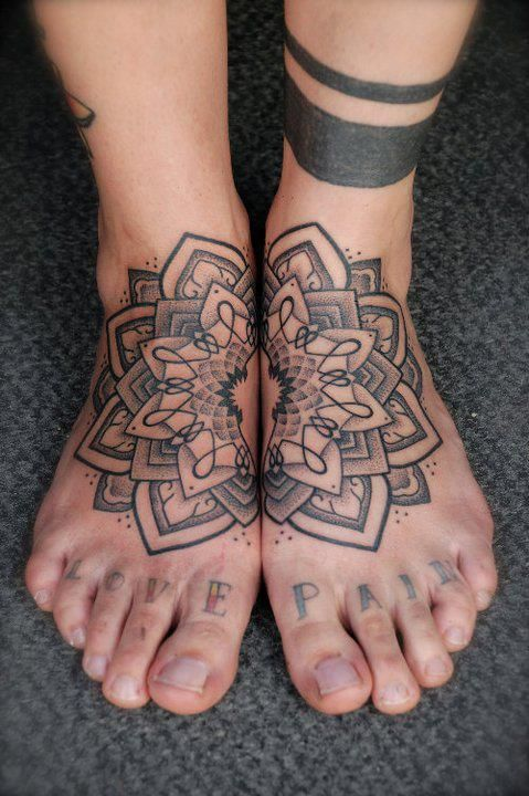 Lotus tattoo on some feet.. Ouch! maybe each half on the inside of your forearms..