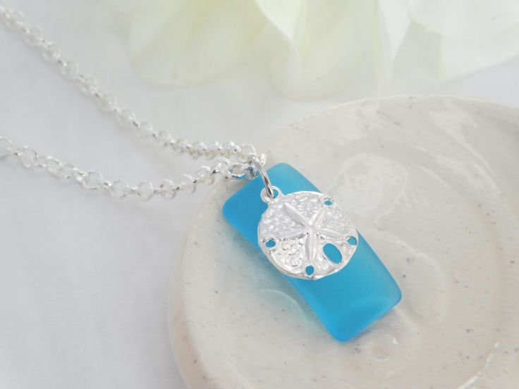 Excited to share the latest addition to my #etsy shop: Sand Dollar Necklace - Blue Sea Glass - Pendant Necklace - Sterling Silver Charm - Silver Plated Chain - Nautical Jewelry - Beach Necklace