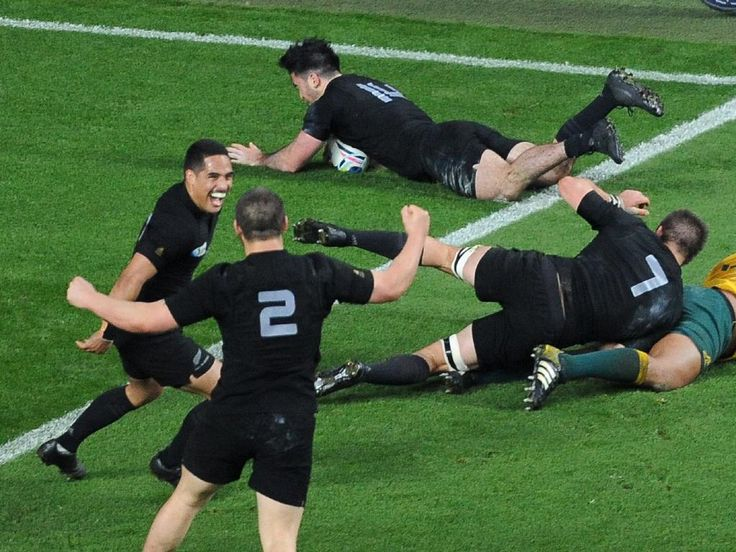 New Zealand's Nehe Milner-Skudder top, dives across to score a try as his teammates celebrate. Credit: AP Photo/Rob Taggart