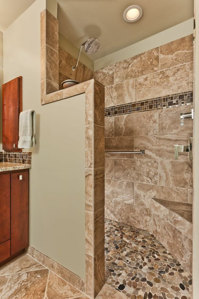 Shows Shower Wall Not All The Way To Ceiling, Stone Pebbles For Floor,  Corner Bench, Larger Stone And Accent Row Way Up Wall