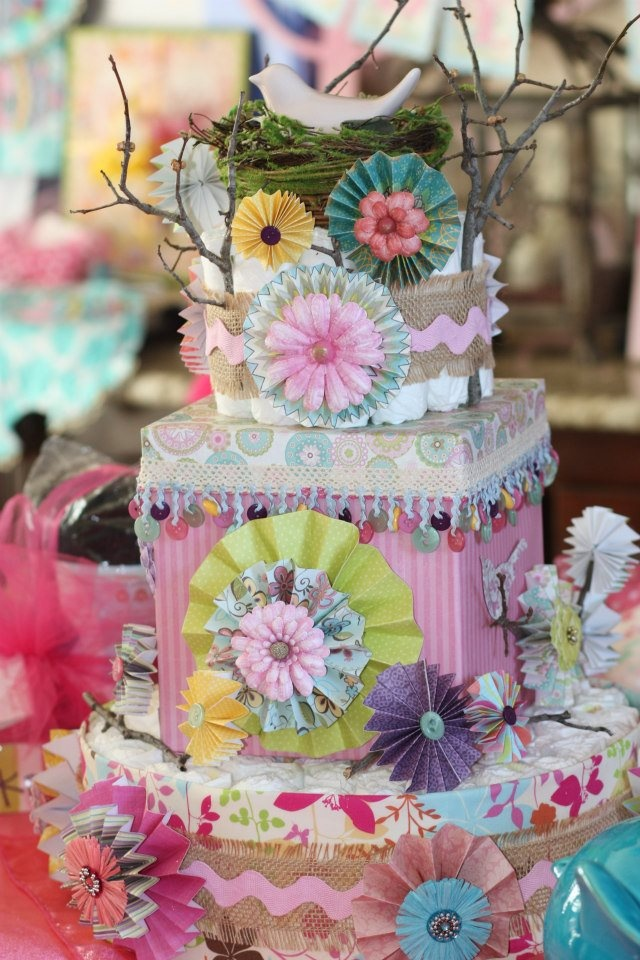 This is a diaper cake I made for my sis-in-law's baby shower. She has a tree and bird painted on the wall, so I used it as my inspiration. It is made mainly with scrapbook paper and embellishments.
