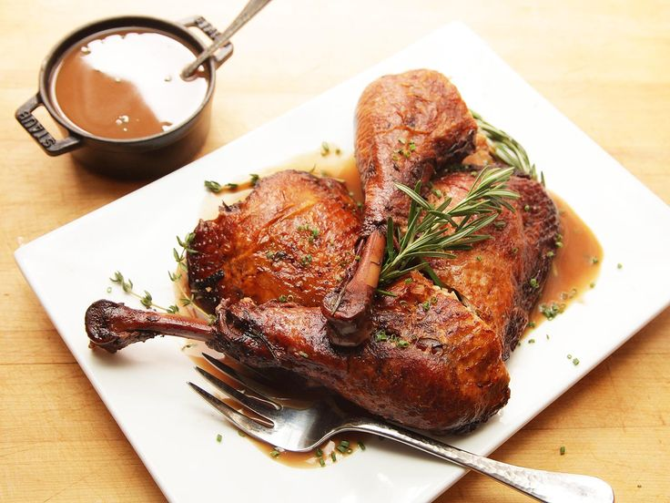 Tender braised turkey legs with crispy skin and a savory red wine gravy.