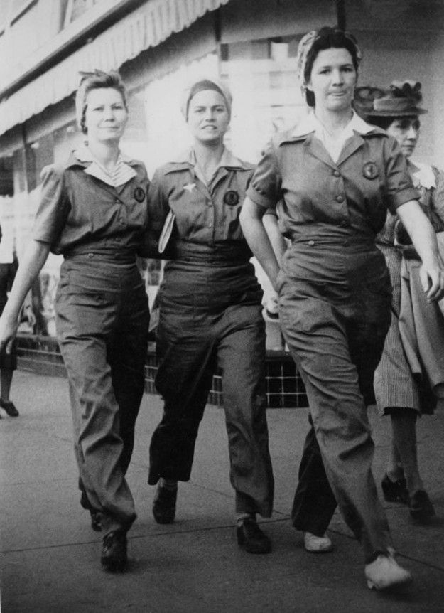"Houston Street in Fort Worth back in 1942. All three were ""Rosie the Riveters"" at the North American plant there. They worked on the P-51 Mustang Fighter. The photo was taken by a street photographer in downtown Fort Worth. According to the note left on the photo by Wanda's mom, they were headed to Leonard's to buy a dress for her as she had a date with a man named Larry Lenz. That's three nice l..."