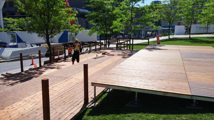 Setting up 3000 sq ft split level deck for Les Francofolies de Montréal, Bistro SAQ https://www.mega-stage.com/