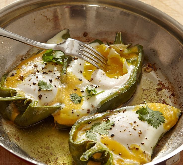 "Eggs in Pepper Boats Recipe - Jacques Pepin - ""One day I decided to cook eggs in sweet peppers with a bit of cheese and cilantro. It made a great lunch dish. I used the long, pale green peppers sometimes called banana peppers. Poblano and cubanelle peppers also work, especially if you want to add a little heat."""