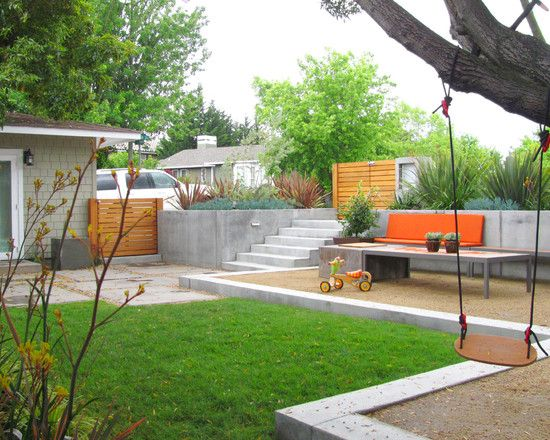 Kid Friendly Design -- the swing, the seating, the pavers, the bit of soft grass (or ground cover) to play, the multiple outdoor rooms, this is the vibe to always consider when designing our yard