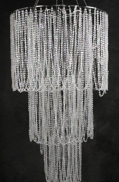 make it out of beads from the dollar store spray them silver if i ever have a girl maybe pink over a crib