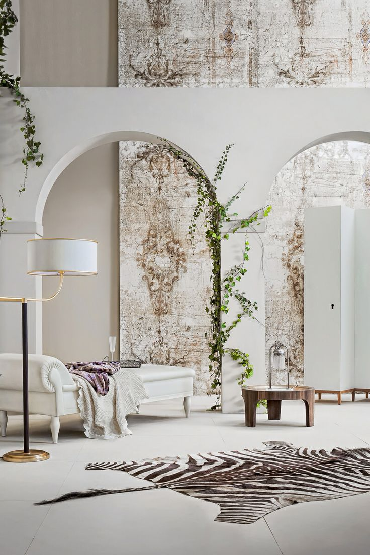 interior design: mediterranean style with fern on wall, white chaise lounge chair, zebra animal hide rug (b)