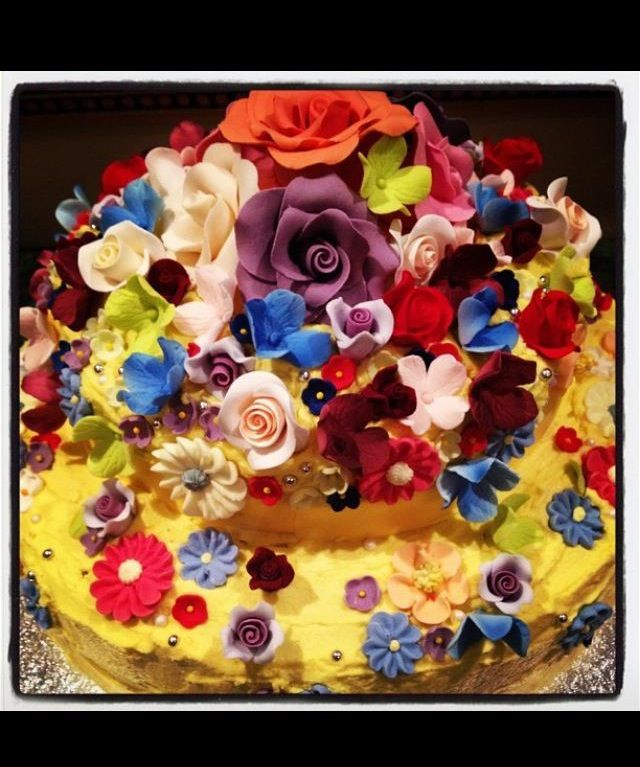 Two Tiered Cake with Coconut layer and Marbled Raspberry and vanilla layer topped with sugared flowers