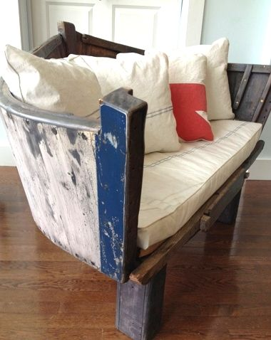 A boat stern chair crafted from a 1940's fishing boat that had sunk into the mud. Pillows are sailcloth. That's creative recycling