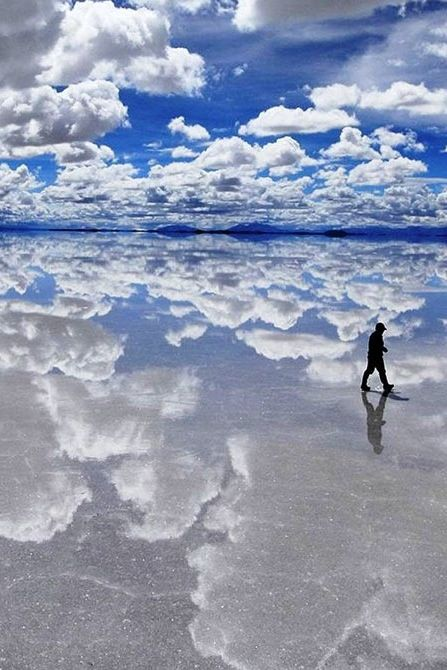 The Salt Flat - Bolivia: You're not walking on the clouds--although you will feel like it when you explore Bolivia's Salar de Uyuni, the largest salt flat in the world, where a desert of salt spans more than 4,500 miles.