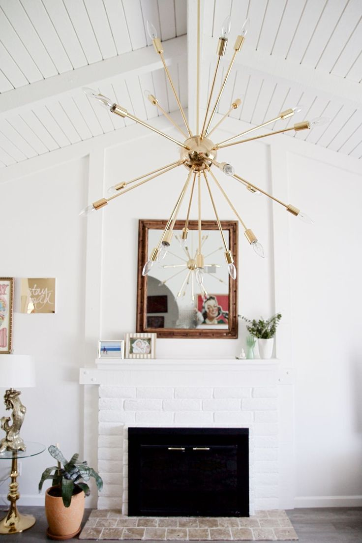 All white living room with exposed beams and sputnik chandelier