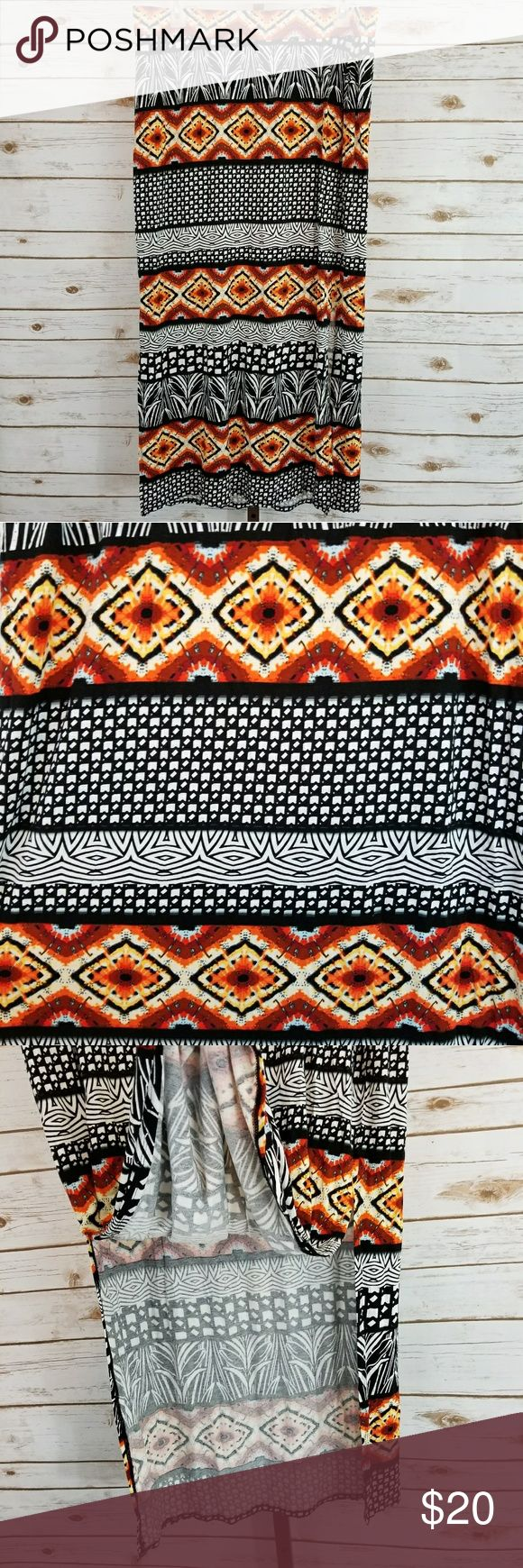 """Lane Bryant 18/20 Orange Black Tribal Maxi Skirt Beautiful tribal print maxi skirt from Lane Bryant! Very soft and stretchy rayon/spandex blend. 18"""" slit on each side adds saucy flair! Total skirt length is 40"""". Waist band is 19"""" across but stretches to 24"""" across. In excellent pre-owned condition! Lane Bryant Skirts Maxi"""