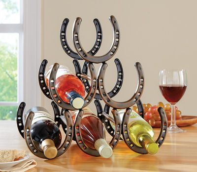 Rustic Horseshoe Wine Bottle Holder. OK, you could buy this wine rack made to look like it's made out of horseshoes.... Or, if you are a real horse lover, you could gather up some real horse's shoes and put them together in a similar way -- perhaps just by using metal wire to clasp them together side-by-side, and run slim dowel rods back to front.