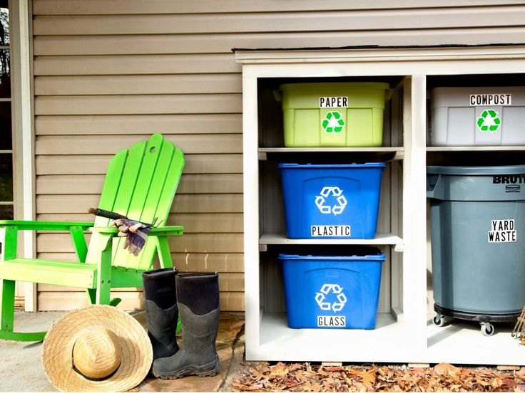 Recycling and waste bins are neatly stacked and sheltered in this streamlined recycling center made from basic building materials.