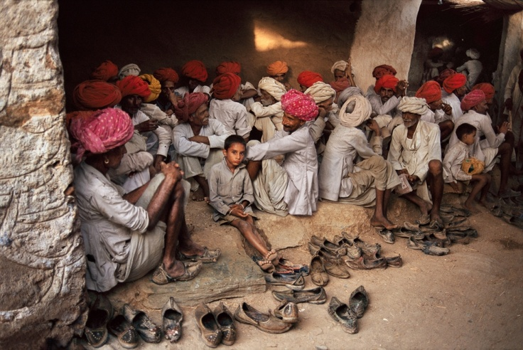 Rajasthan, India  A boy listens as theelders talk at a traditional wedding festival. Steve McCurry