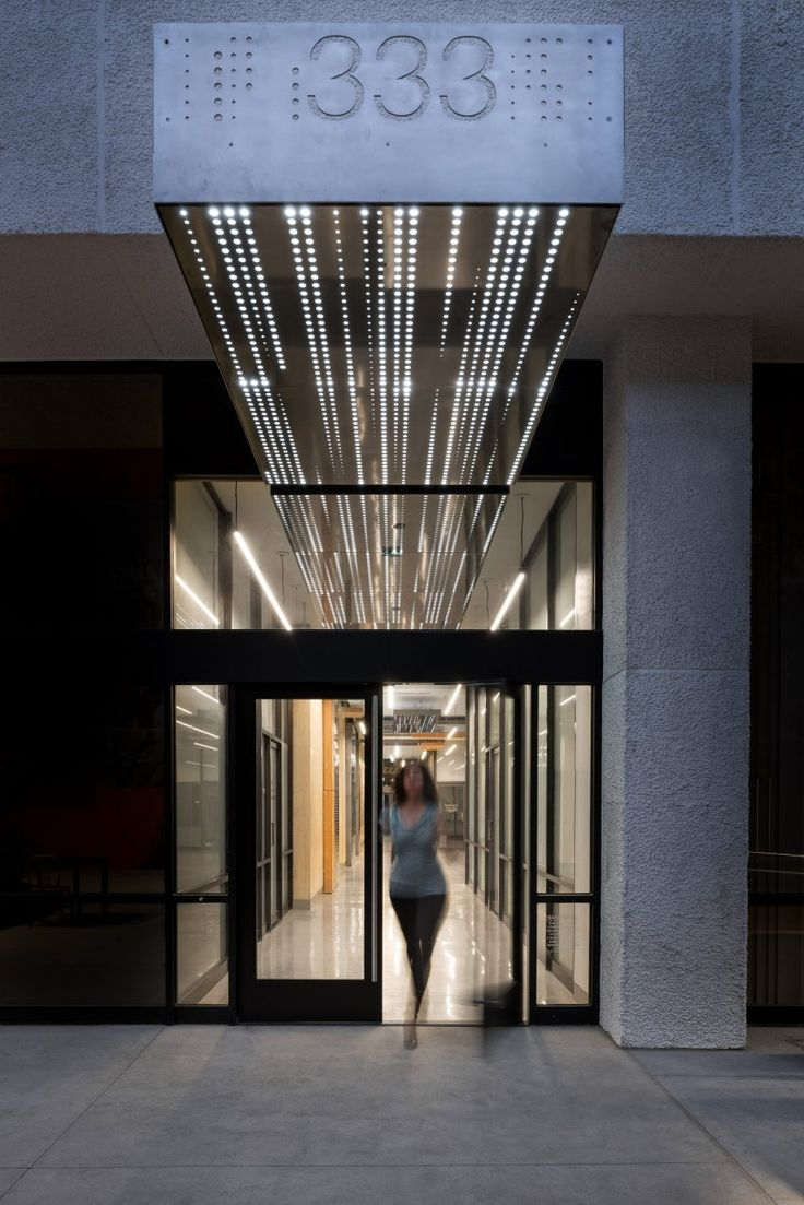Connexion by Patrick Tighe Dotted perforations create glowing patterns for California offices revamped by Tighe Architecture
