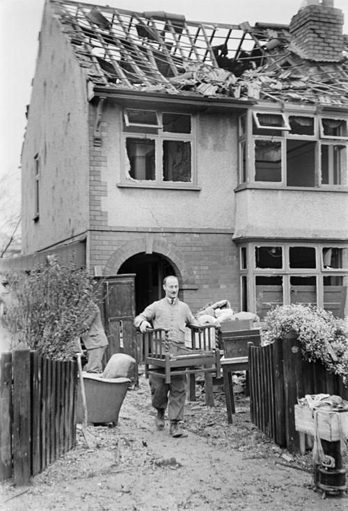 Residents of Coventry salvaging what they can from their destroyed homes the morning after a Luftwaffe bombing - 15 November 1940       Photo by George Rodger