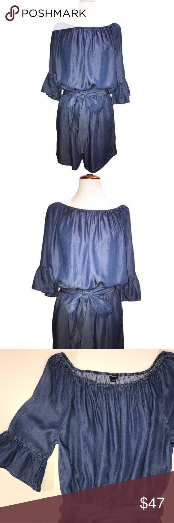I 🖤 Ronson Blue Faux Jean Romper I 🖤 Ronson shorts romper. Faux jean look, soft and smooth fabric, blue with a slight shimmery hue. Wide neckline, ruffled sleeves and a wide ribbon waist tie. Generous fitting and elastic waist gives this romper a very blousy fit. Great condition. Charlotte Ronson Pants Jumpsuits & Rompers