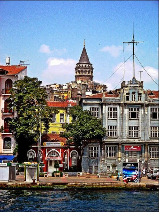 Galata Tower, in the old Genoese (circa 1348) part of Istanbul, peeks from behind jumble of ancient streets leading up from the crossroads of the ancient world -- Galata astride the Bosphorus and the Golden Horn, how GOLDEN is that ?