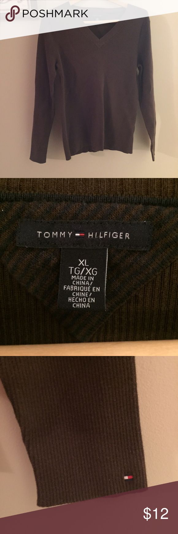 Tommy Hilfiger Ribbed V-neck Gorgeous brown ribbed Tommy Hilfiger shirt. Looks like a sweater but feels like a tee. Super cozy, soft and stylish.  Dress it up or down for whatever the occasion. Gently loved condition. Happy poshing!!! ❤️❤️❤️ Tommy Hilfiger Tops