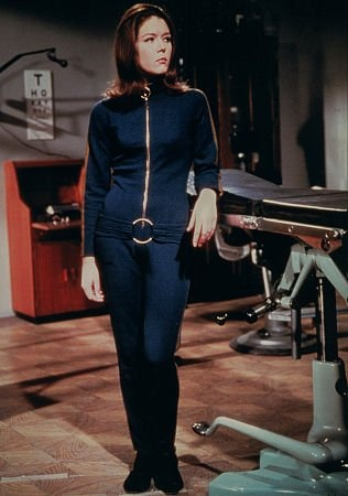 Diana Rigg as Emma Peel. Watching Avengers reruns from the Emma Peel era is my first memory of a strong, smart female character on TV who was a heroine, not a damsel in distress.