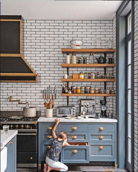 open shelving kitchen with brass handles and subway tiles
