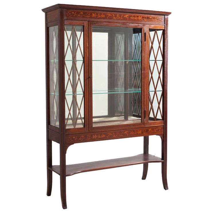 This American Curio/Vitrine has glass panels supported by glazing bars in a trellis pattern. It showcases all the awards your favorite stars may take home at the People's Choice Awards.