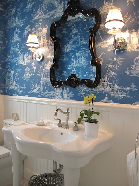 Blue and white bathroom with Thibaut wallpaper and ceramic pedestal basin