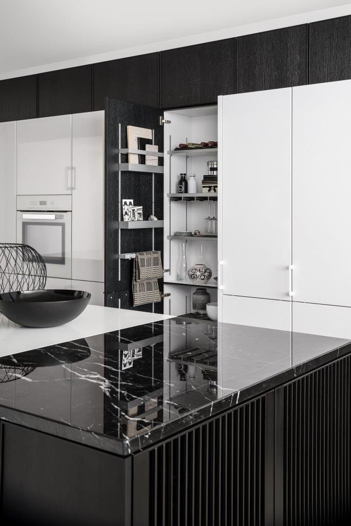 Glossy White Kitchen Cabinetry Solves Organizational Needs, And Pops  Perfectly Off Of The Sophisticated Black Marble. By SieMatic.