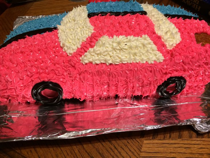 I have twin boys and for their 7th birthday they wanted a race car cake. One boy wanted red the other wanted blue so we split it down the middle. I used black licorice for the wheels and for the racing stripe separating the two colors. I have one boy who doesn't really care for icing so I left the bumper corner area clean of icing for him. I used a racecar cake mold. We put 7 candles on the front hood and 7 on the back trunk so each boy had his own candles to blow out.