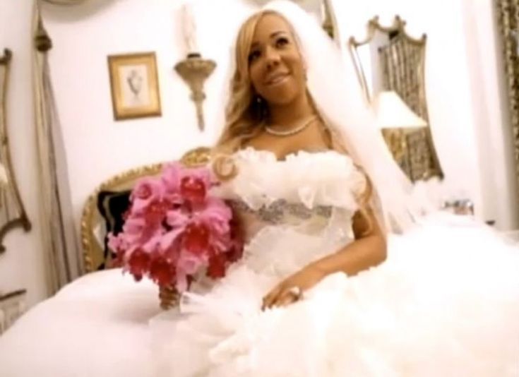 """Celebrity Wedding Dresses -  Tameka """"Tiny"""" Cottle married rapper T.I. wearing a dreamy cloud of a gown with a sea of ruffles."""