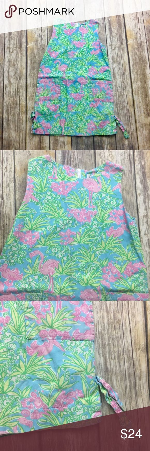 Lilly Pulitzer Tropical Flamingo Shift Dress Tropical flamingo shift dress. Size 7. Fully lined. In excellent used condition . 25 inches long. 14 inches arm pit to arm pit. Pockets and bows on sides. Light cotton and polyester material Lilly Pulitzer Dresses Casual